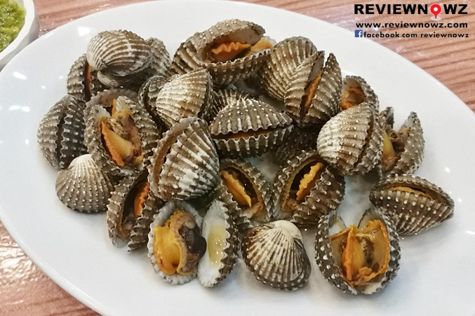Poached cockles